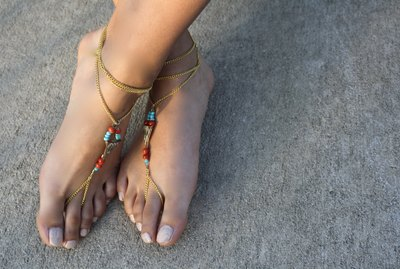 pink sandals on female feet