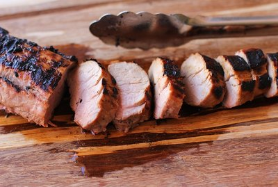 Grilled pork tenderloin on a cutting board