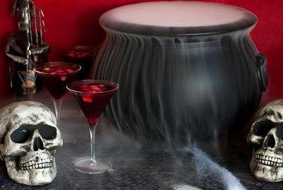 Smokey cauldron with sangria glasses and skulls