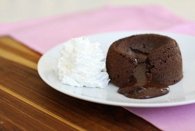 Hot molten chocolate lava cake with whipped cream.