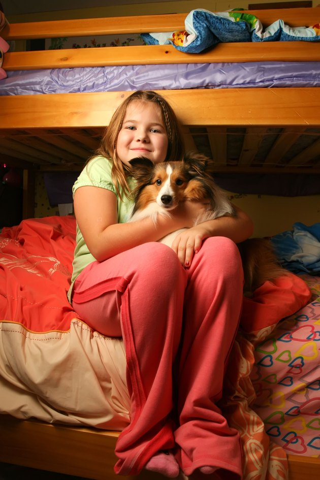 Young girl in her bedroom with pet
