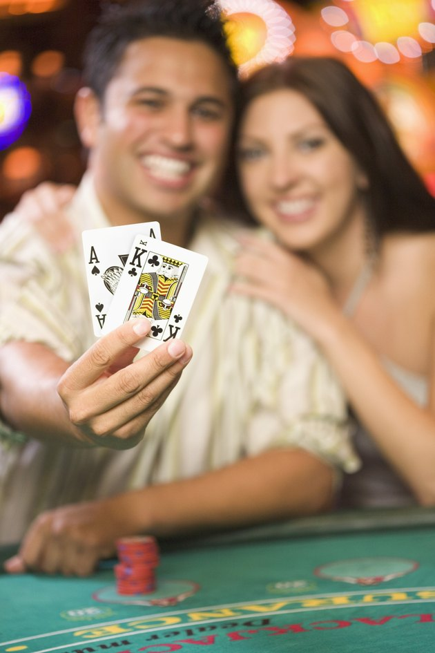 Man Holding Winning Blackjack Cards