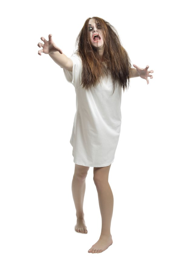 Young zombie girl isolated