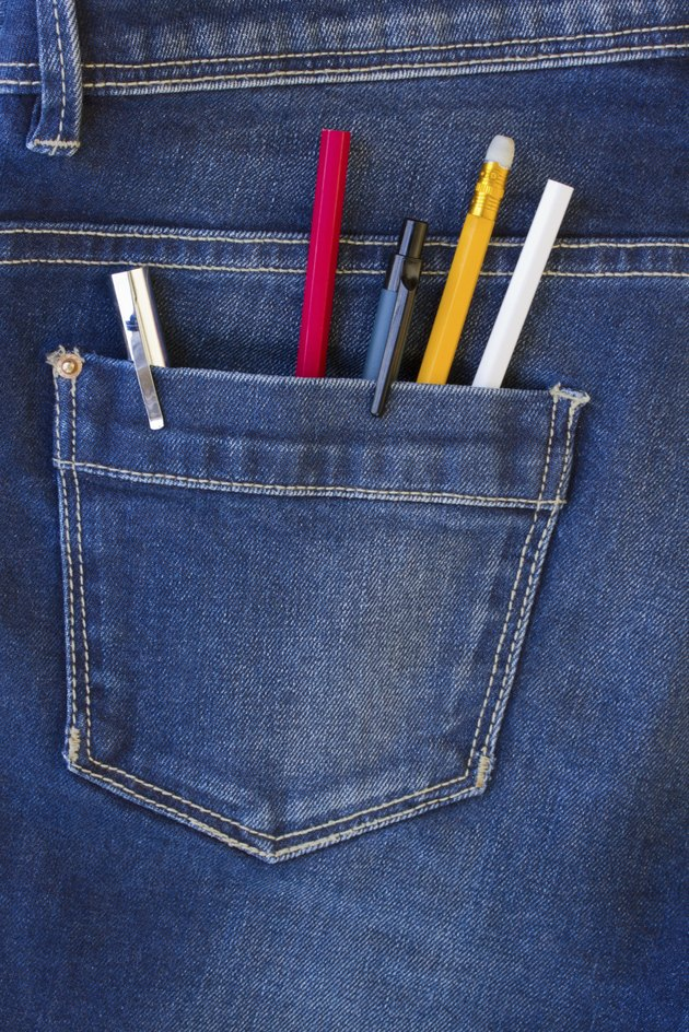blue jeans pocket full of pens and pencils