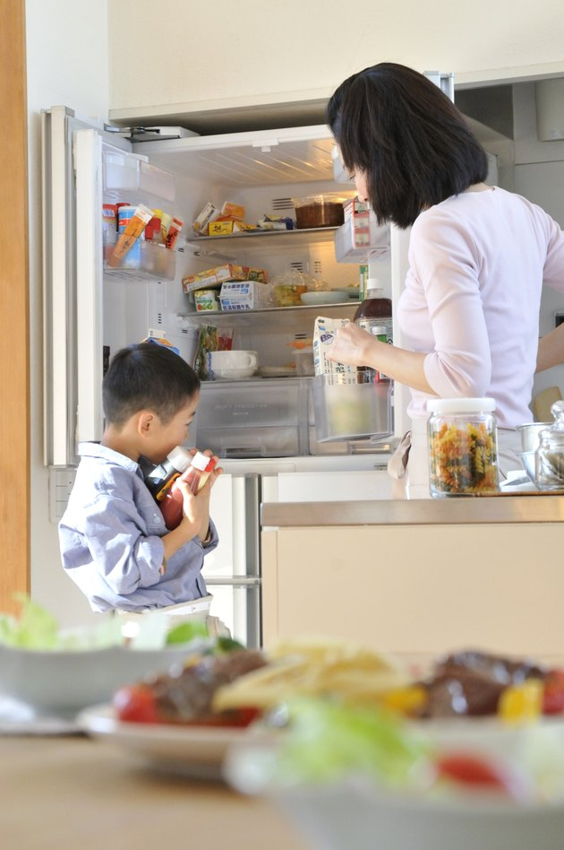 Mother and Son Opening Refrigerator
