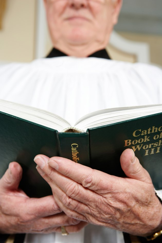 Priest reading from Book of Worship