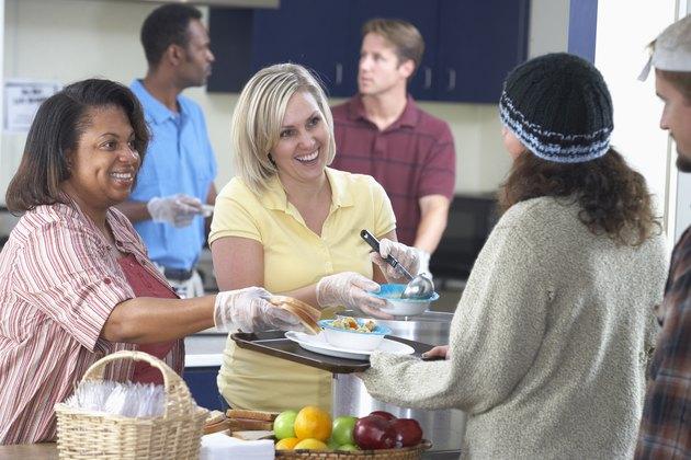 Women serving food at soup kitchen