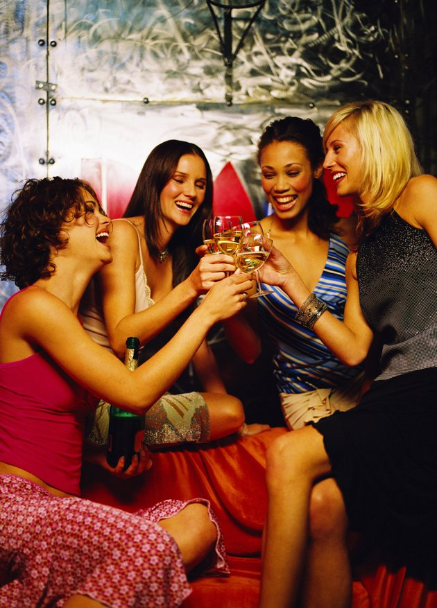 Group of young women toasting with wine glasses
