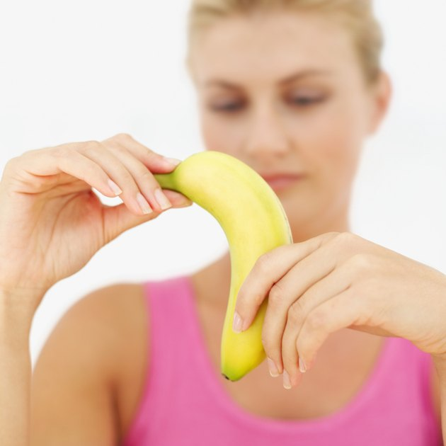 Close-up of a banana in a young woman's hands