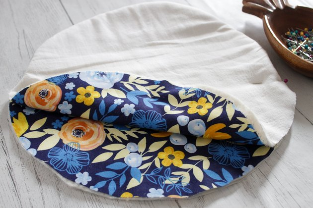 The guacamole is fresh, the onions are diced, the cheese is shredded, and the table is set. All you need now, to make your taco night perfect, is a handmade, cotton fabric tortilla warmer.