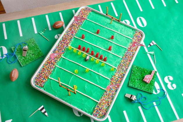 Stadium cake baked into sheet pan and decorated with gummy bears and sprinkles