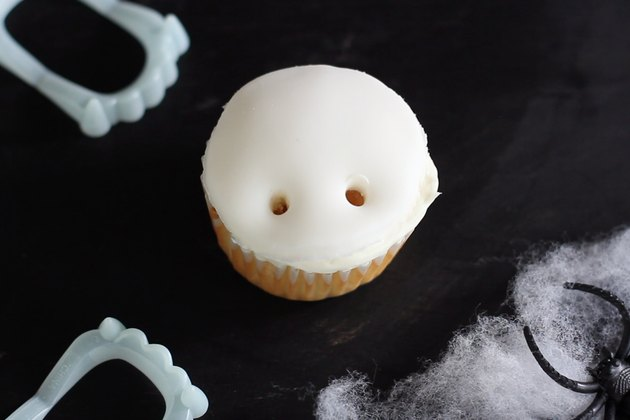 Two holes poked into cupcake