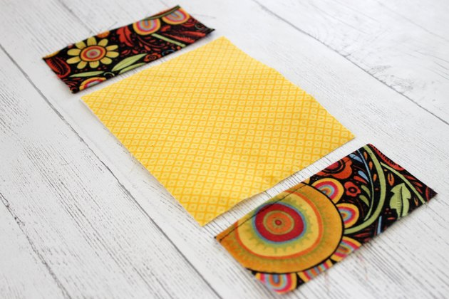 Whip up a card holder from some fabric scraps and keep your business cards organized and clean.