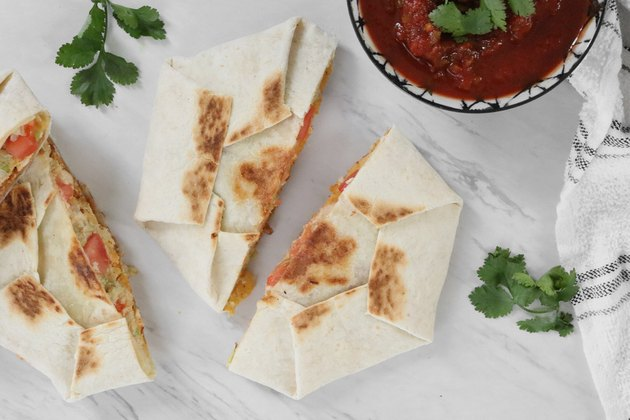 Vegan copycat Crunchwrap with salsa and cilantro