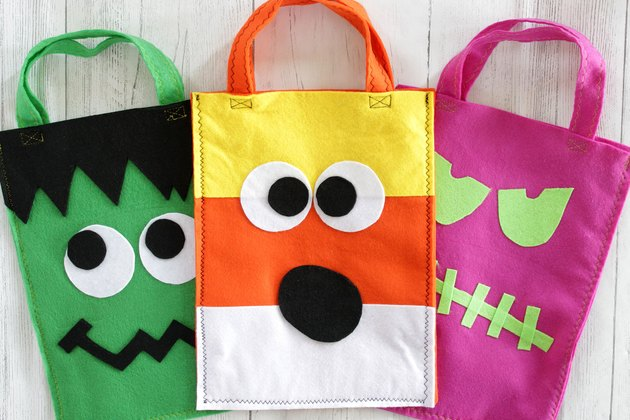 The front porch is decorated, pumpkins are carved, and costumes are made. Now it's time to create cute, felt trick or treat bags for your scary little ghosts and goblins.