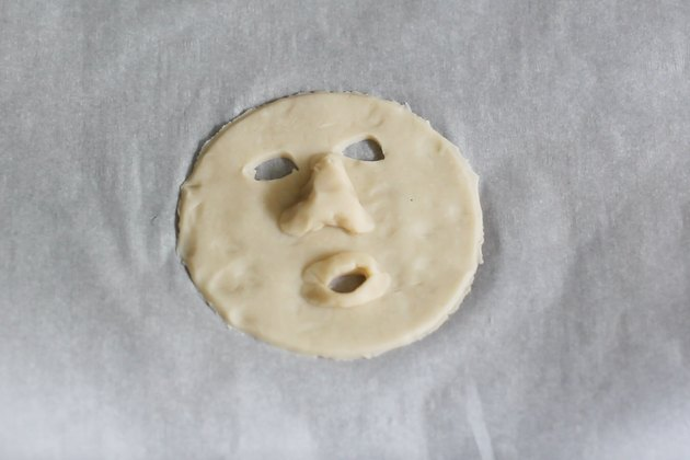 Shrunken head features shaped into dough
