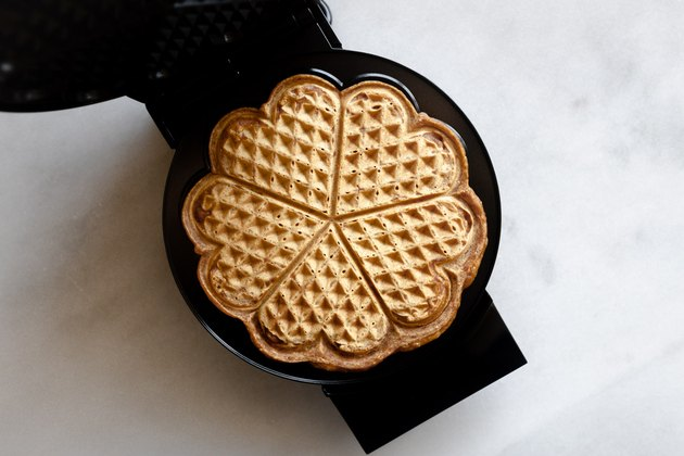 Cook the waffle until it is golden and crisp.