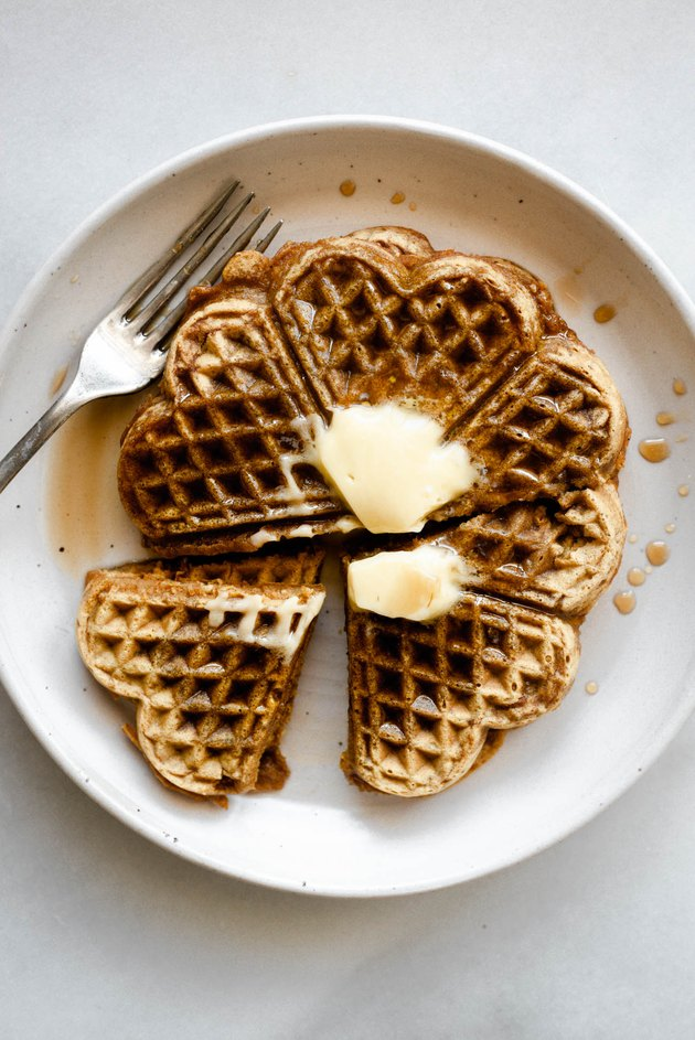 Serve the waffles with a pat of butter and an extra drizzle of maple syrup!