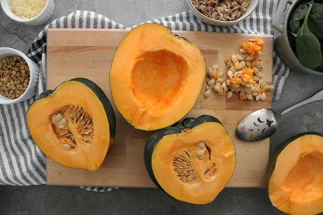 Slice the acorn squash