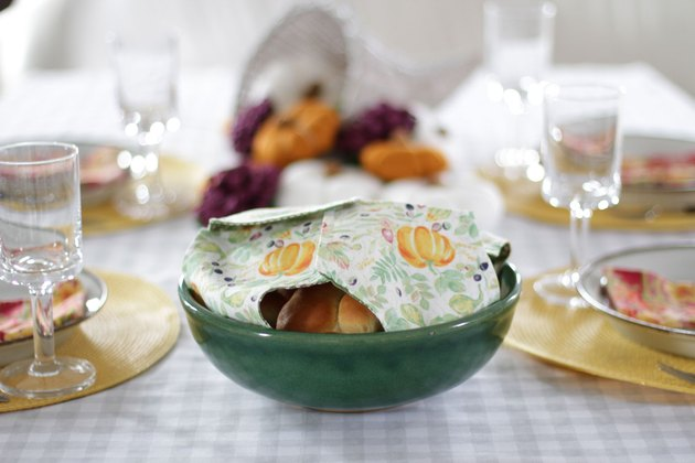 This holiday season, keep your rolls fresh and, at the same time, add some serious style to your table with a DIY fabric roll cover.