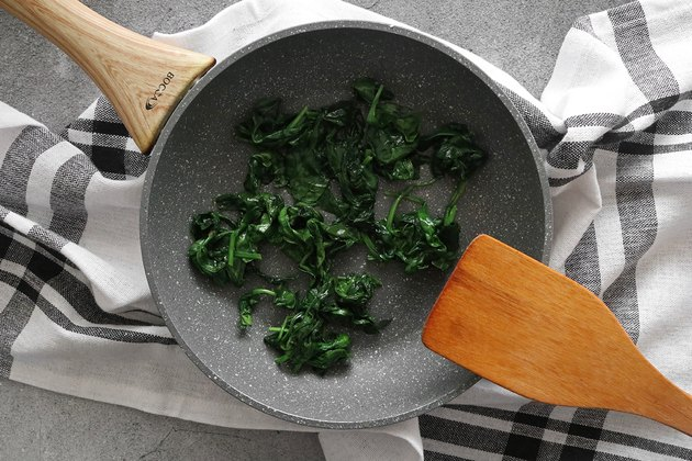 Cook spinach until wilted