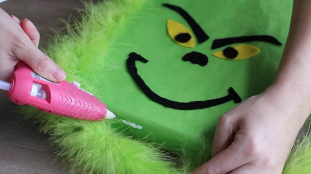 Gluing green feather boa in place