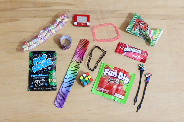 Assorted 90s nostalgia items and candy