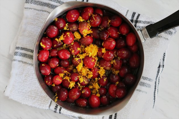 Combine cranberries and orange zest