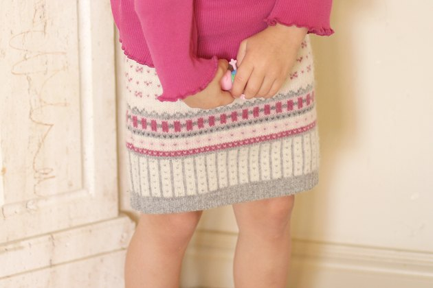 Pull out an old sweater from the bottom of your closet and create a cute and cozy sweater skirt for a little girl in your life.