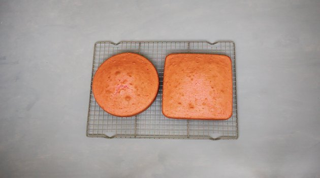 Round and square cake on cooling rack