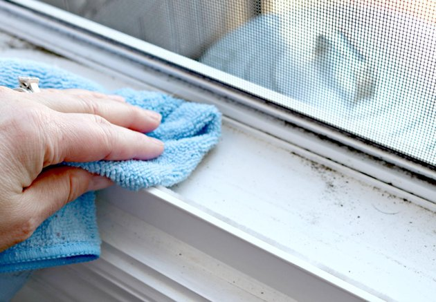 Wiping dirt from window tracks