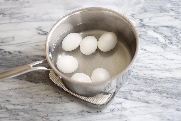 Six eggs in pan of water