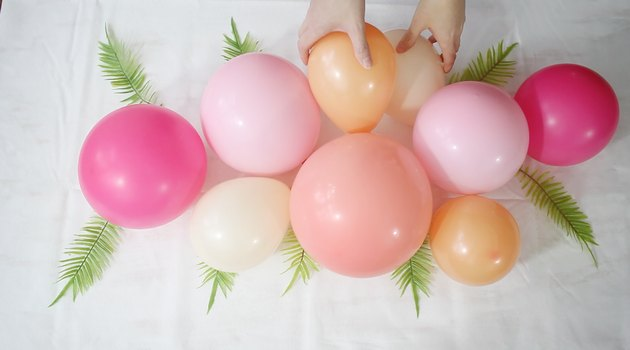 gluing smaller balloon to larger ones