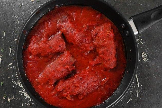 Cook braciole in tomato sauce
