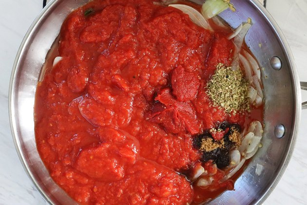 Cook tomato sauce