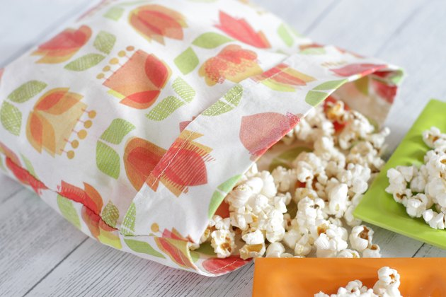 If you've been trying to create less waste and eat a bit healthier, you can ditch those greasy, chemical-laden, store-bought microwave popcorn bags and make an earth-friendly, reusable, healthy alternative.