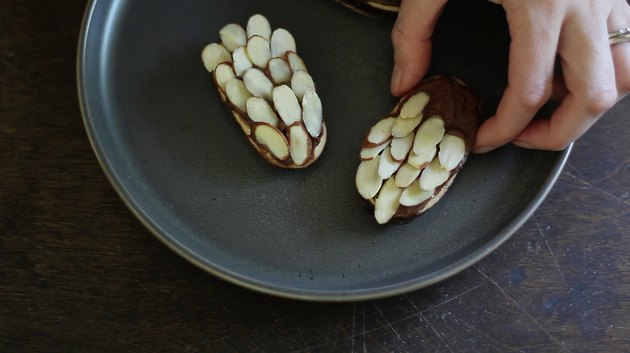Sticking almonds into frosting