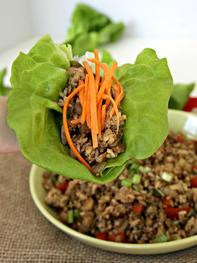 ground turkey in wrap with garnish for healthy turkey lettuce wraps