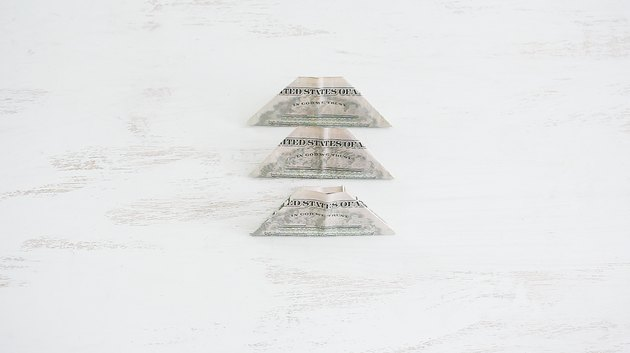 Three folded bills