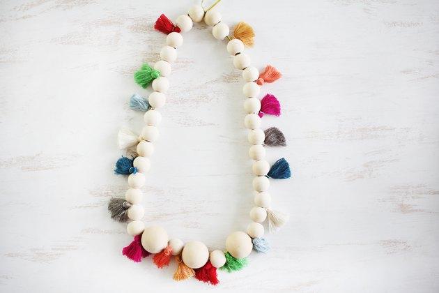 Wood bead and tassel lei
