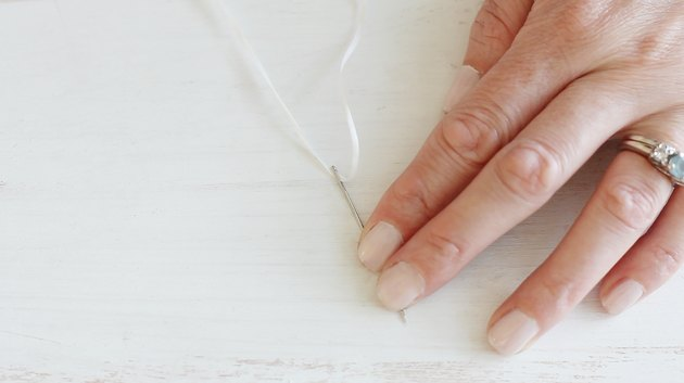 Threading needle with string