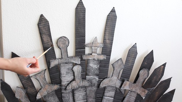 Dry brushing copper paint onto spikes