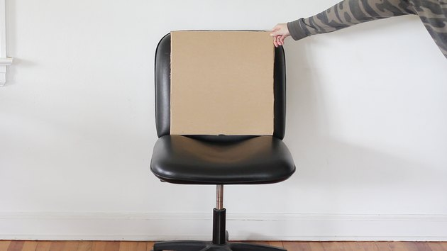 Cardboard cut to size of chair back