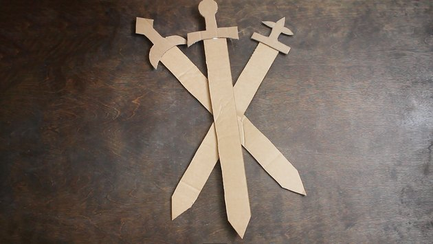 Three cardboard swords