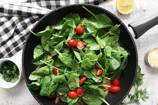 Add spinach and tomatoes