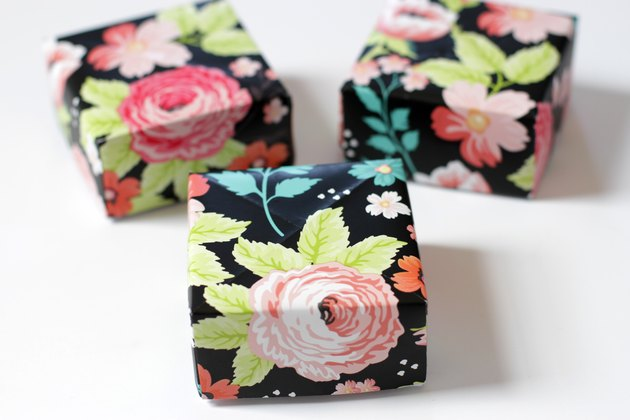 Make a big dramatic statement with a little paper box. They're perfect for those times when you need to add a little flair to a small gift for a friend or loved one. They even make great little wedding favor boxes.