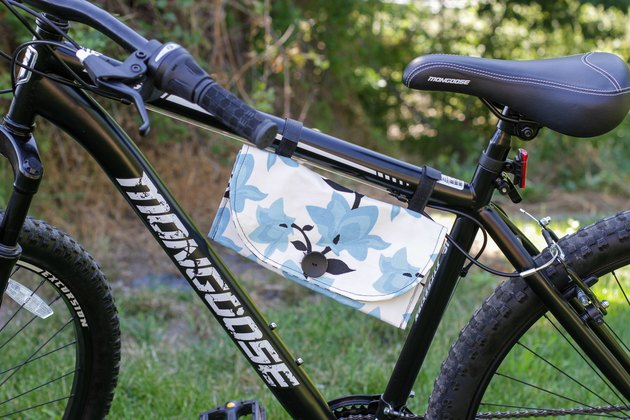 If you've recently taken to the road on a bike, and you love to sew, then this DIY bike pouch could be a perfect way to combine two of your favorite hobbies and create a spot to carry a few essentials while taking to the open road.