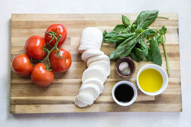 ingredients for caprese salad on a cutting board