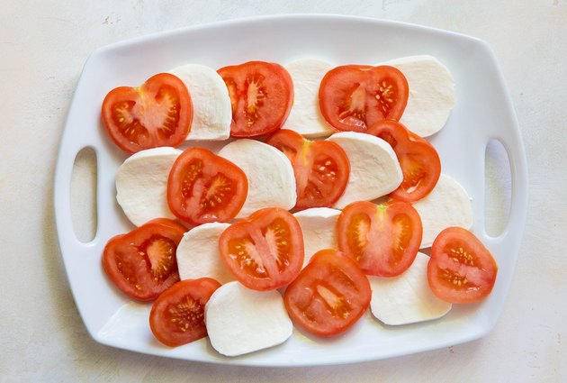 tomatoes and mozzarella cheese on a platter