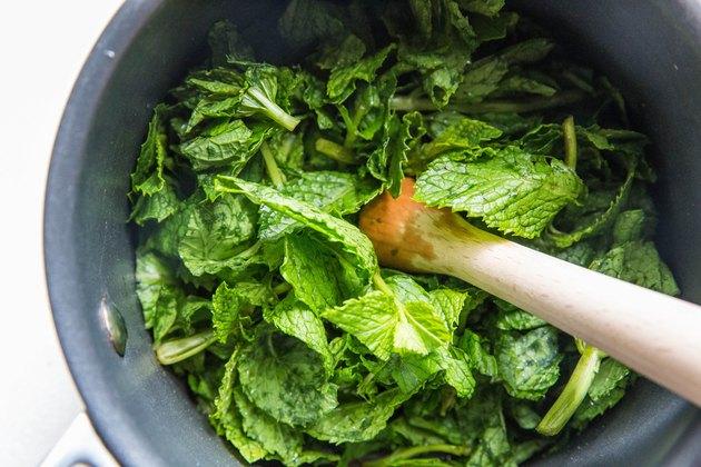 muddling mint in a saucepan